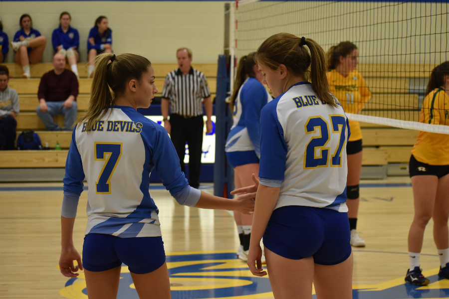 Sicily Yingling (7) and Hope Shook (27) wait for a serve against Forest Hills.