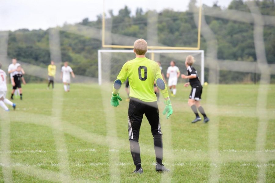 Alex Roberts waits in goal for the co-op soccer team.
