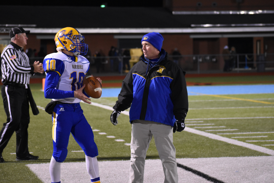 Shawn Wolfe talks with Coach Lovrich prior to the start of the second half against Ligonier Valley,