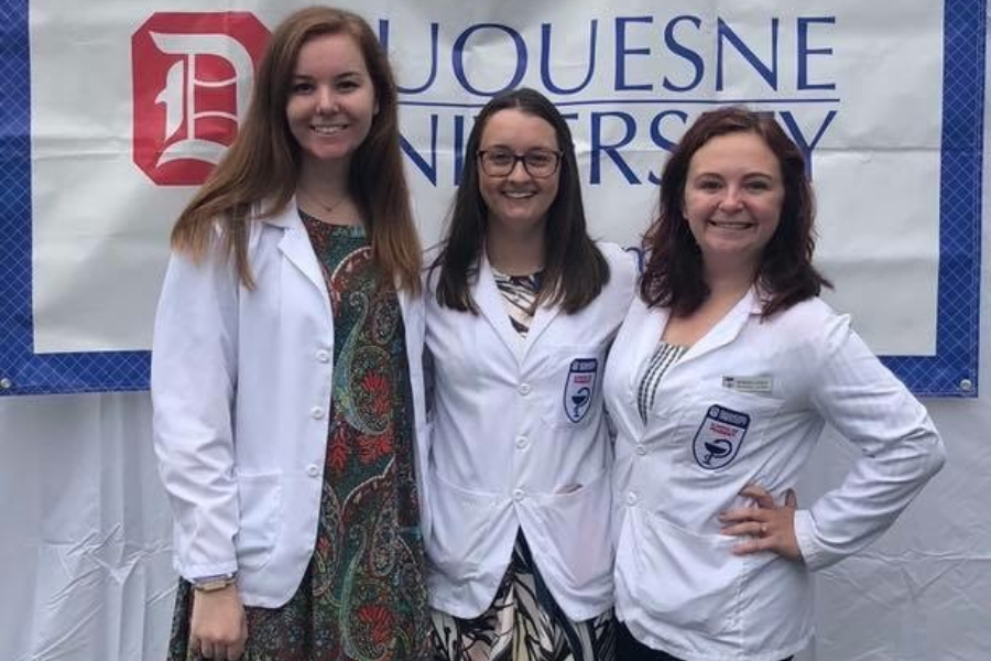Miranda Lowery Burgman (far right) is preparing to enter the mdeical field as she studies at Duquesne.