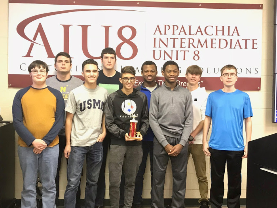 Scholastic Scrimmafge team members (l to r) Philip Chamberllin, Caden Nagle, Paulino Cuevas, Nathan Wolfe, Daniel Kustaborder, Alex Taylor, Aiden Taylor, Kenny Robinson, and John Sloey, took fourth overall at the IU8 competition.