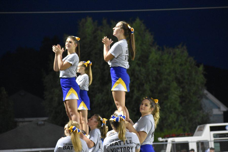 B-A cheerleaders stunting at the Backyard Brawl.