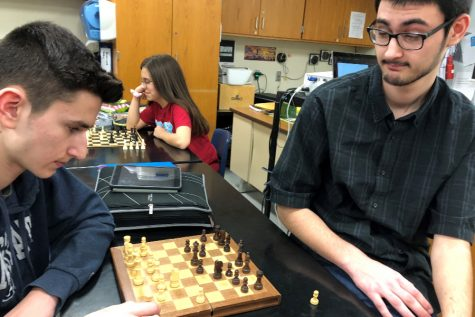Brothers Caedon and Zion Poe square off in Chess Club.