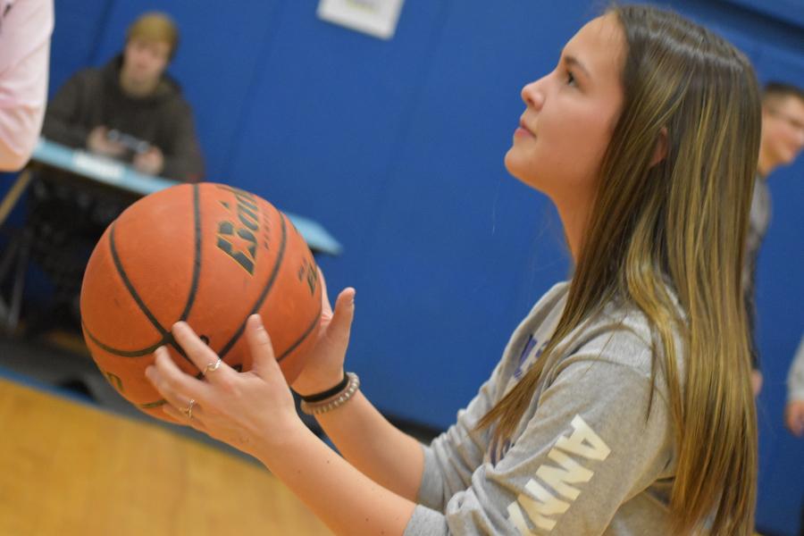 Anna Lovrich shoots a foul shot at the 2018 Activity Fair.