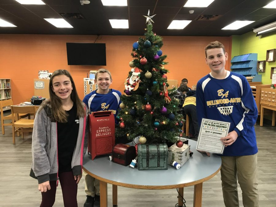 Shawna, Kole and Vincent with the Christmas game they built for the Media Center.