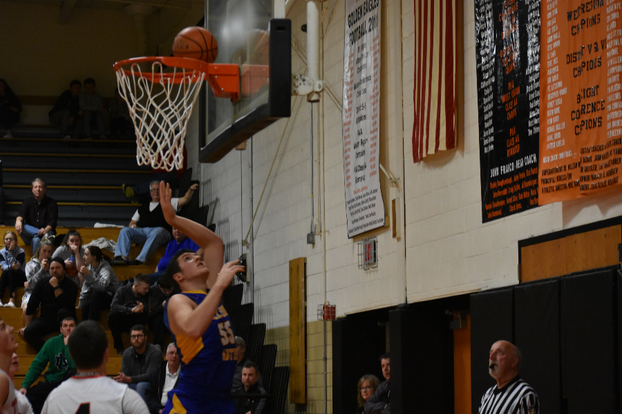 Travis Luensmann goes to the hoop in the championship game of the Reliance Bank Holiday Tournament.