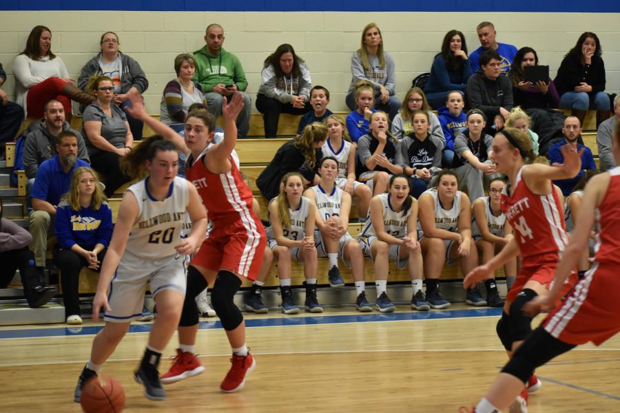 Emilie Leidig drives baseline against Everett.