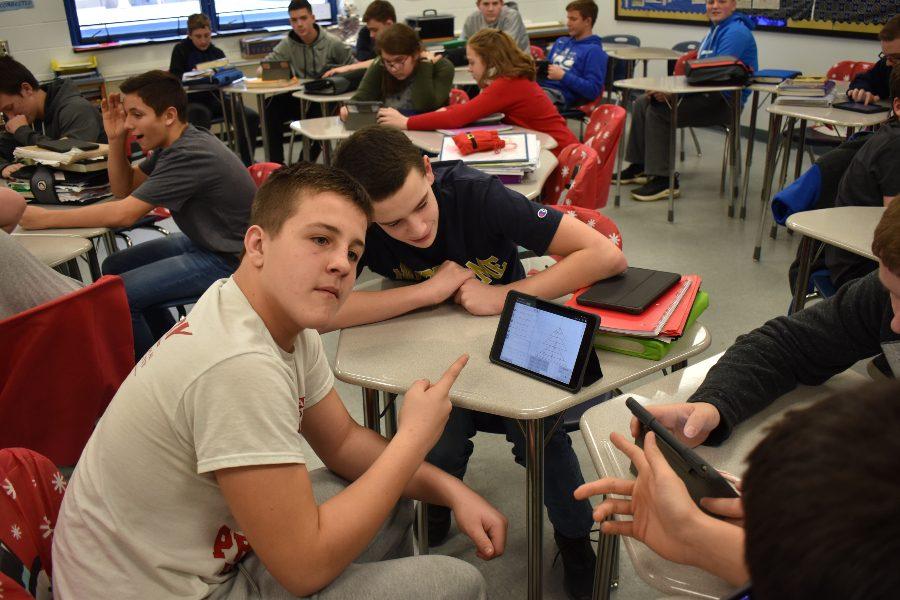 Cooper Guyer and Brandon Cherry discuss a math problem in Mrs. Stinsons class.