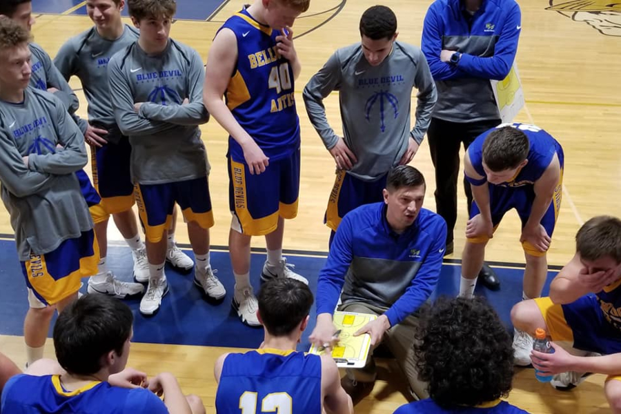 Coach Conlon gives instructions to his team at Mount Union.