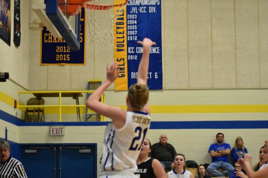Alli Campbell follows through on a three-pointer.