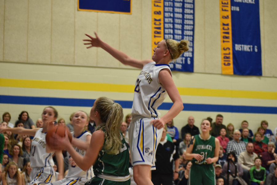 Alli Campbell goes for a block against Juniata Vallley.