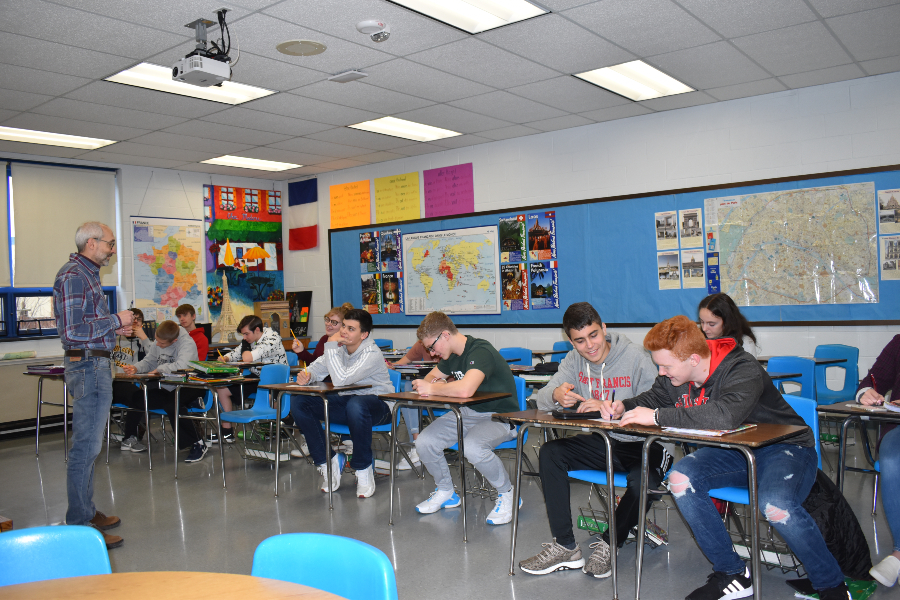 Mr. Van Scoyoc works with his French II class.