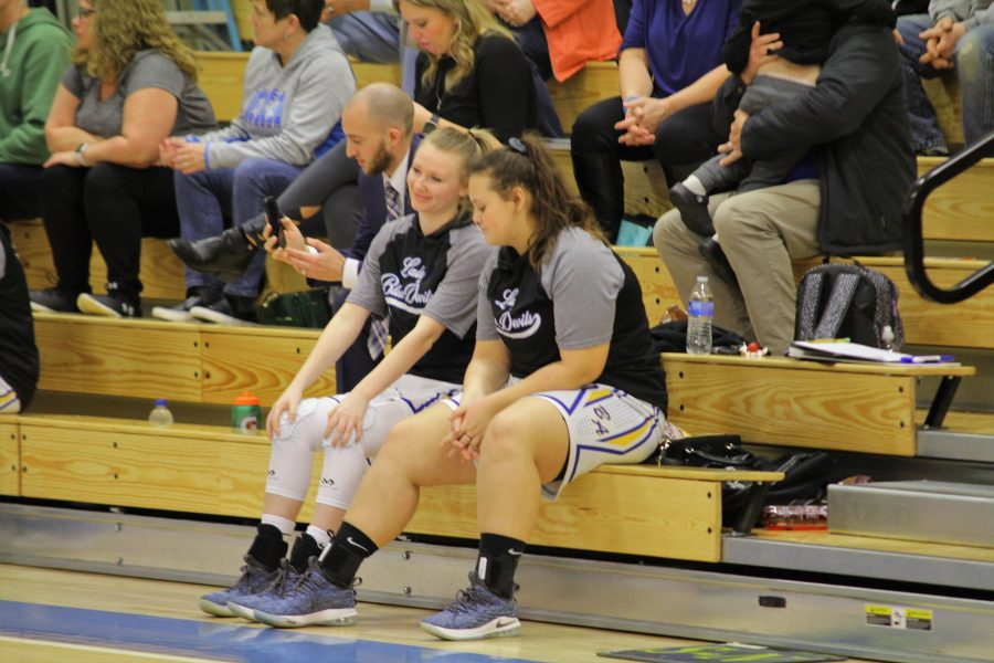 Seniors Ali Wagner and Riley D'Angelo wait to be called to the floor for their Senior Night basketball ceremonies.