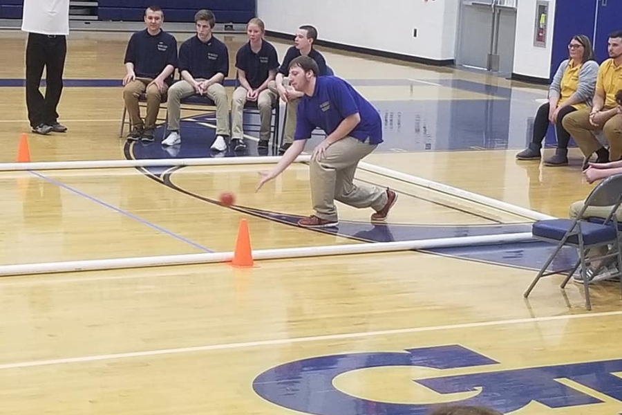 Tyler Long takes his turn in the bocce team's win over Hollidaysburg.
