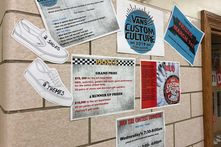 Students can get an entry form for the Vans Custom Design contest outside the main office.