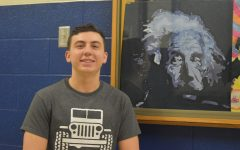 Lincoln Boyer poses with one of his paintings from art class.