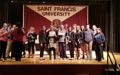 Speech team wins title; sends three to nationals