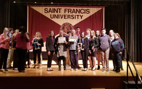 Speech team wins title; sends three to nationals