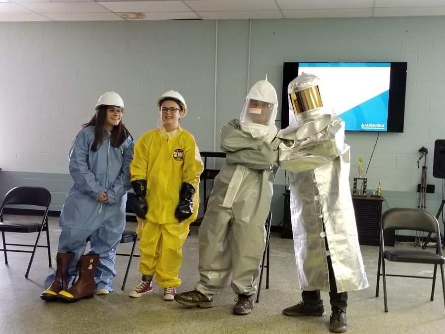 Students trying on protective gear at the Albemarle Chemical Plant in Tyrone.