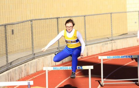 Brianna Reiter competing in the 100m hurdles.