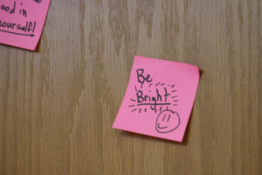 Ms. Forshey has enthusiastic post-it notes on her door,  including this one