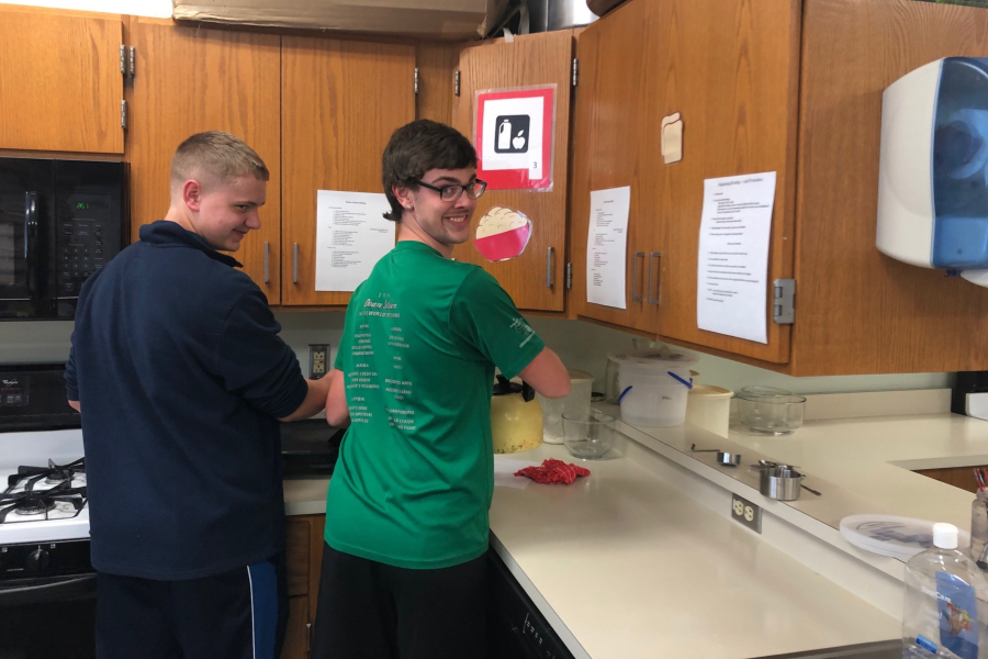 Jacob Fitzgerald, right, loves to cook pancakes and help his classmates in Home Ec.