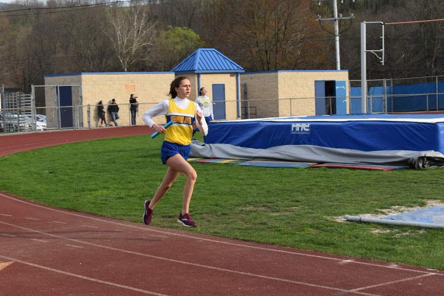 Sophia Nelson completes a lap for her relay team.
