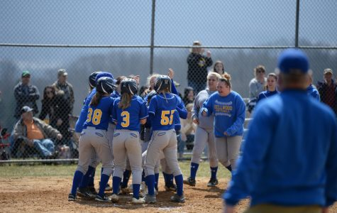 The softball team celebrates at home plate after a late grand slam by Haley Schmidt against Tyrone.