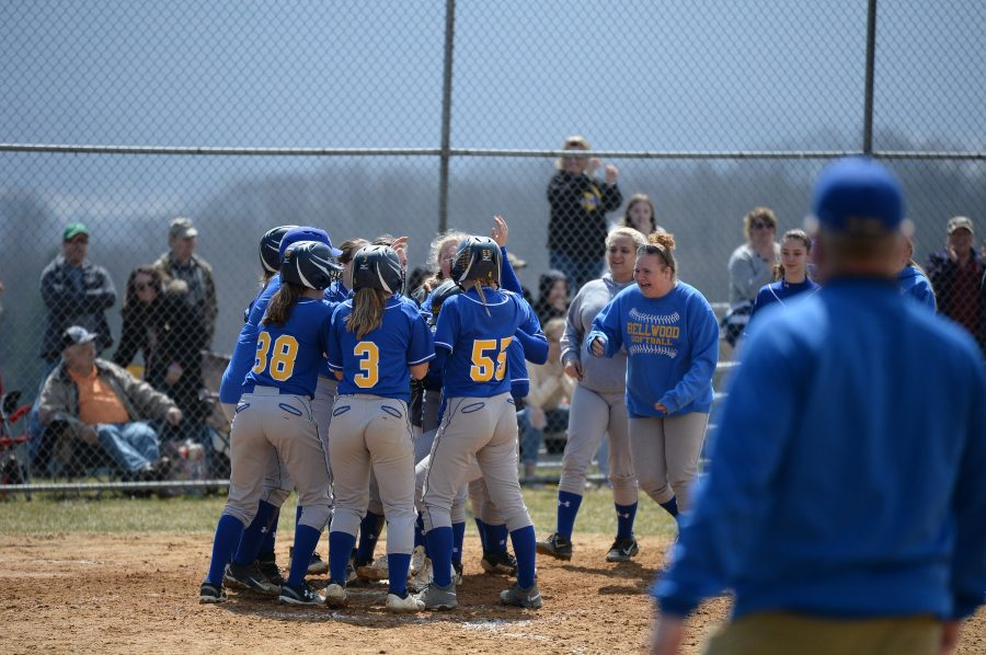The+softball+team+celebrates+at+home+plate+after+a+late+grand+slam+by+Haley+Schmidt+against+Tyrone.
