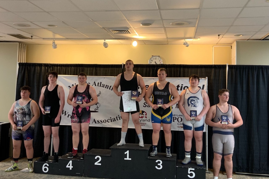 Evan Pellegrine (third from right) took third at the MAWA wrestling tournament over the weekend.