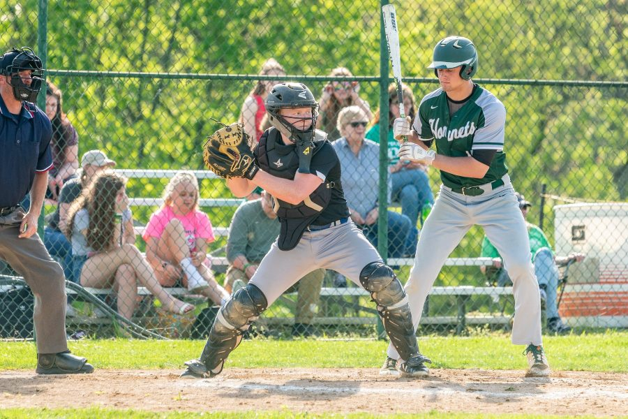 Catcher Nick Plank throws to second base against Juniata Valley.
