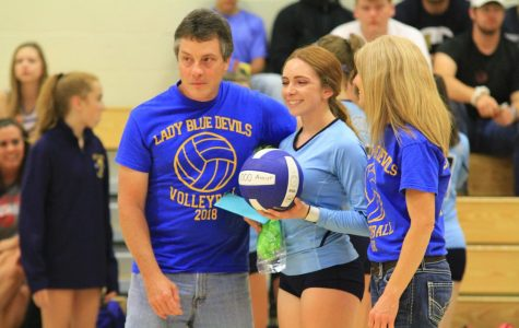 Lady Devils spikers earn first win