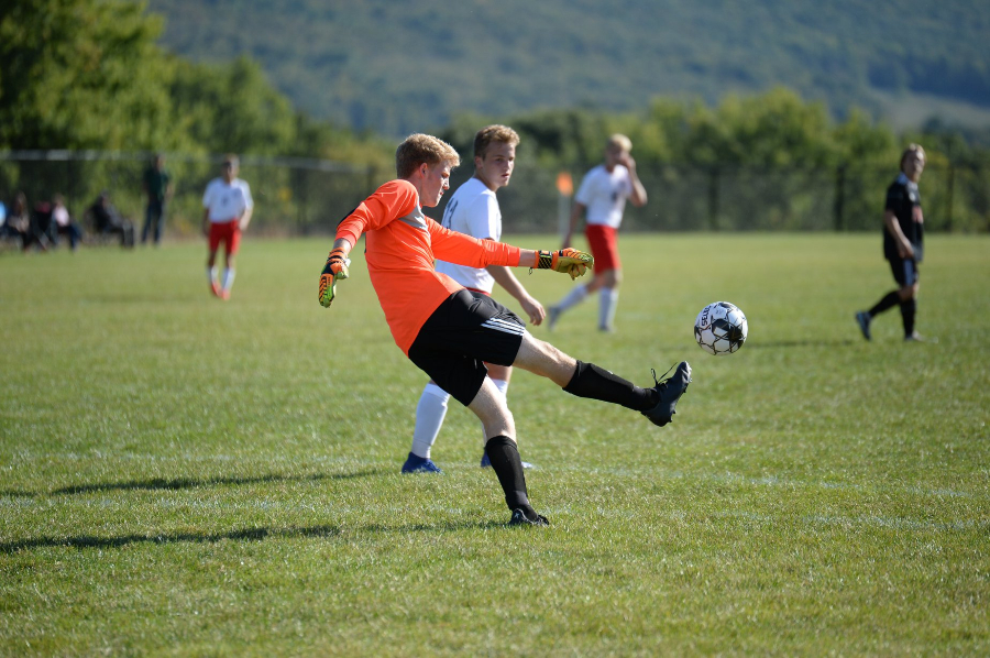 Goal keeper Alex Roberts clears the ball against Central.