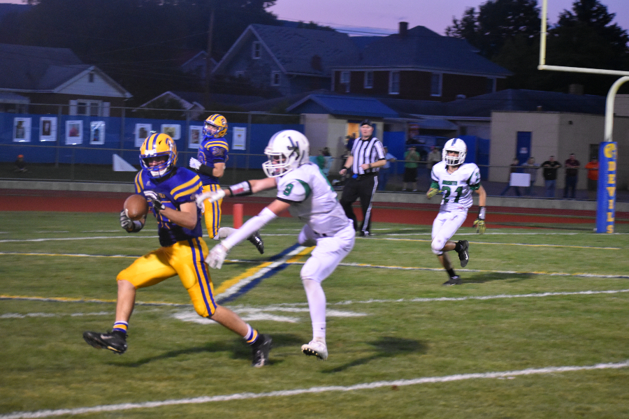 Troy Walker breaks free after catching a pass from Trevor Miller.