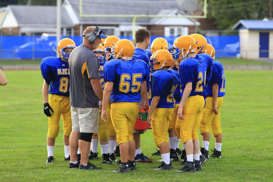 Coach Erickson gathers his junior high team for a word last season,.