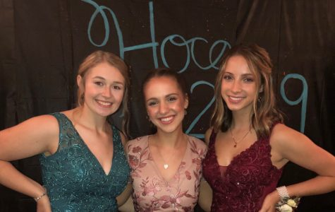 Caroline Nagle, center, poses with court members Casi Shade and Jaydyn Shuke, at Saturday's Homecoming dance.