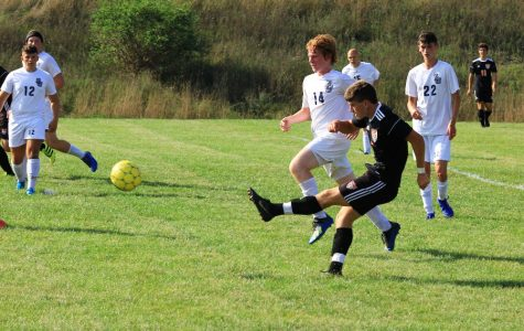 Soccer team gets first win for Coach Bartlett