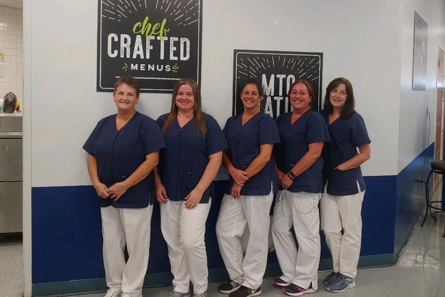Cafeteria workers (l to r) Deb Rhoades, Krista Spiker, Brandi Mercer, Nancy McFarland-Hostler, and Pam Gray received a $100-dollar reward last week.