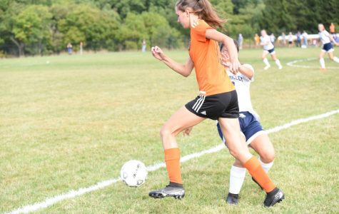 Sophia Nelson pushes the ball ahead against Penns Valley.