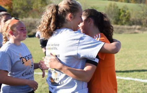 B-A sophomore Jaylee Shuke hugs Tyrone's Cate Baran during Senior Day ceremonies for the girls soccer team.