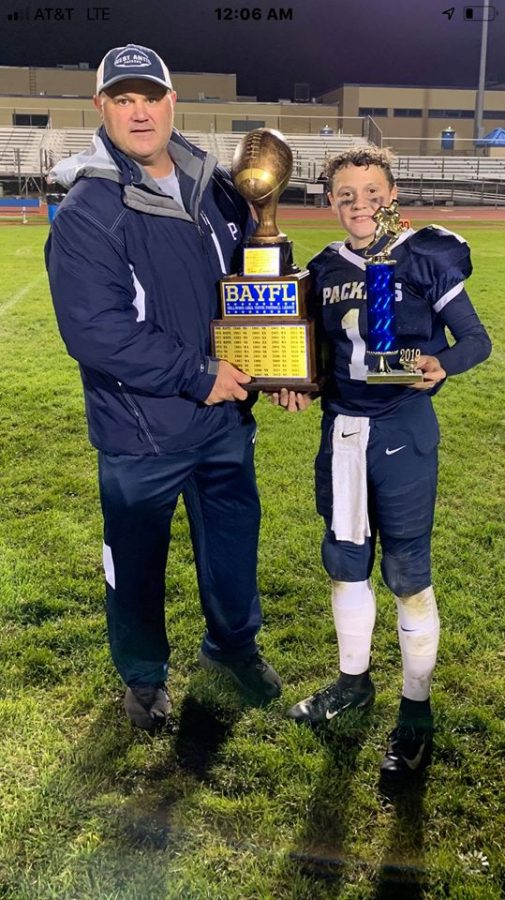 Alex and his dad Chris helped West Antis win a youth football title.