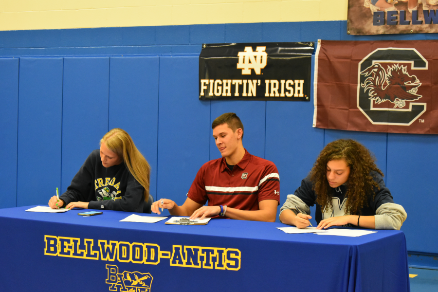 Alli+Campbell%2C+Travis+Luensmann%2C+and+Sakeria+Haralson+signed+National+Letters+of+Intent+yesterday+to+play+Division+I+sports.