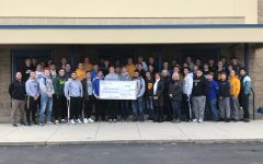 Football team makes donation for breast cancer