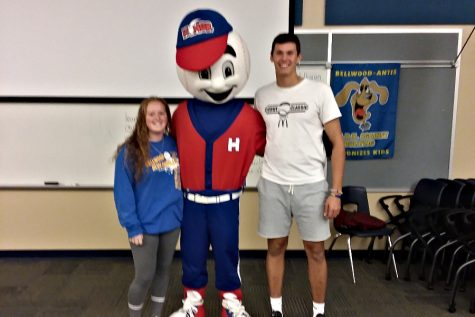Travis Luensmann and Haley Schmidt pose for a picture with Homer for Red Ribbon Week.