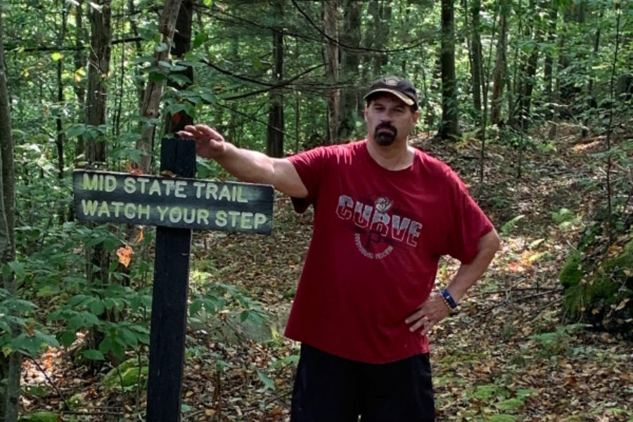 Mr. Goodman recently hiking on the Mid State Trail.