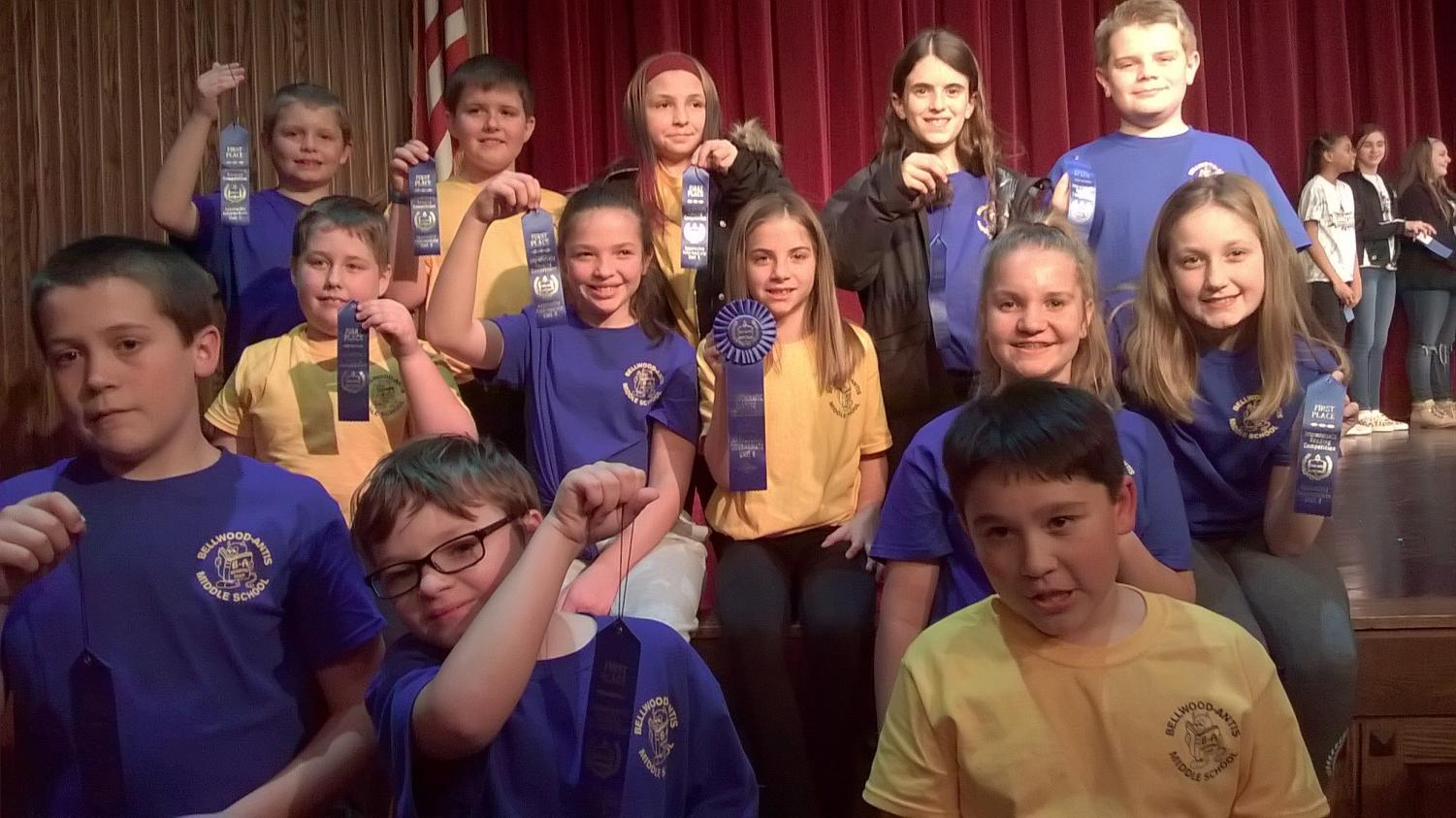 Members of the 5th & 6th Reading Competition showing off their first place ribbons.