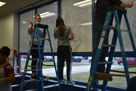 Students participate in a day of giving to the community and decorations in the school. (Zach Miller)