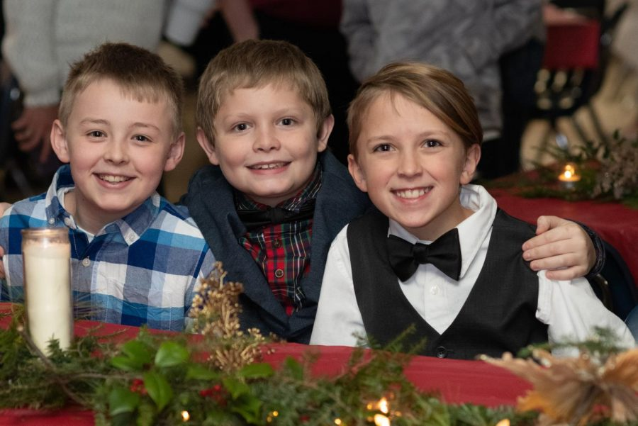 Fifth grade students enjoying the annual Christmas dinner.