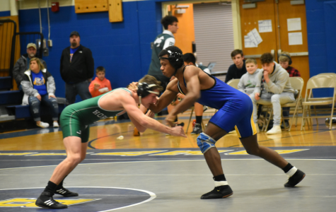 Alex Taylor locks up against Juniata Valley. Taylor earned a spot on the 60-point banner with the win.