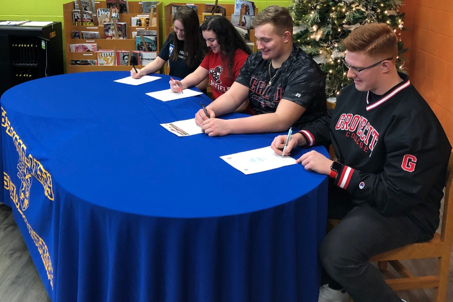 (From left to right) Fraith Patton, Emilie Leidig, Evan Pellegrine and Jackson Boyer each committed to play college sports next year at a signing ceremony on Wednesday.